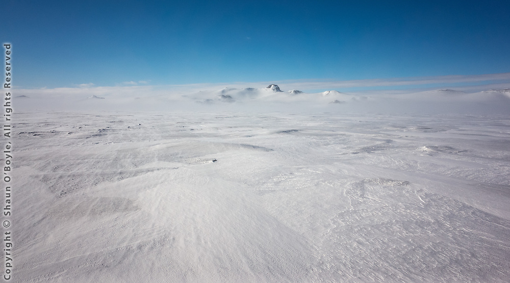 Looking side on at the Hut Point Peninsula from McMurdo Sound. That large rock sticking up is the back side of Castle Rock.