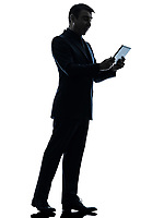 one  business man surprised holding digital tablet in silhouette on white background