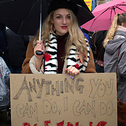 Downing Street, London, England, UK. 21th January 2018. Protesters from Women's March, London gather outside Downing Street to call for time up on gender based violence, sexual harassment, abuse and poverty.