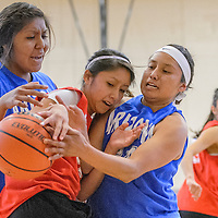 040314       Cable Hoover<br /> <br /> New Mexico's Raquel Spencer (22) and Arizona players Autumn Whitehorse (24) and Shayla Yellowman (25) struggle for control of the ball during the Arizona New Mexico Allstars match at Miyamura High School Thursday.