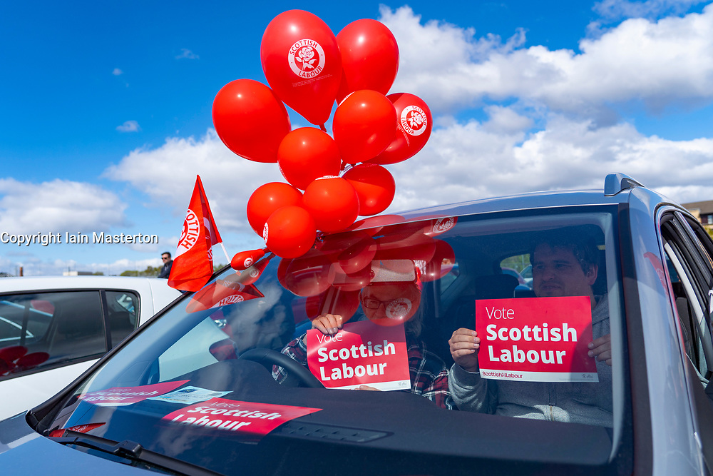 Glasgow, Scotland, UK. 5 May 2021. Scottish Labour Leader Anas Sarwar and former Prime Minister Gordon Brown appear at an eve of polls drive-in campaign rally in Glasgow today. Labour supporters in cars in drive-in rally listen to speeches.   Iain Masterton/Alamy Live News