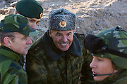 Kamenka, Karelia, Russia, 14/12/2007..Lt. General Nikolai Grigorievich Dimov speaks to Swedish troops in the trenches during Snezhinka [Snowflake] 2007, a joint live fire training exercise for Russian and Swedish motorised infantry in which they play the roles of a combined peace-keeping force enforcing a demilitarised zone in a warring region.