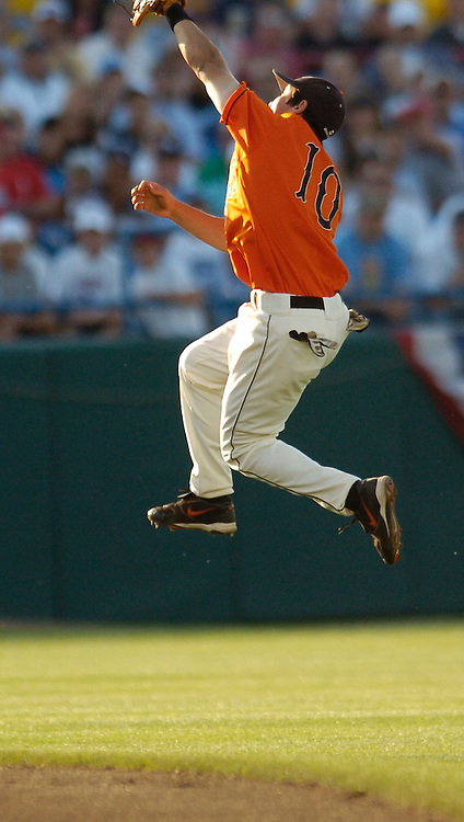 06/22/2006 Oregon State's shortstop Darwin Barney goes up high to catch a line drive during  Game thirteen of the College Word Series in Omaha Nebraska...(photo by Chris Machian/Prairie Pixel Group)