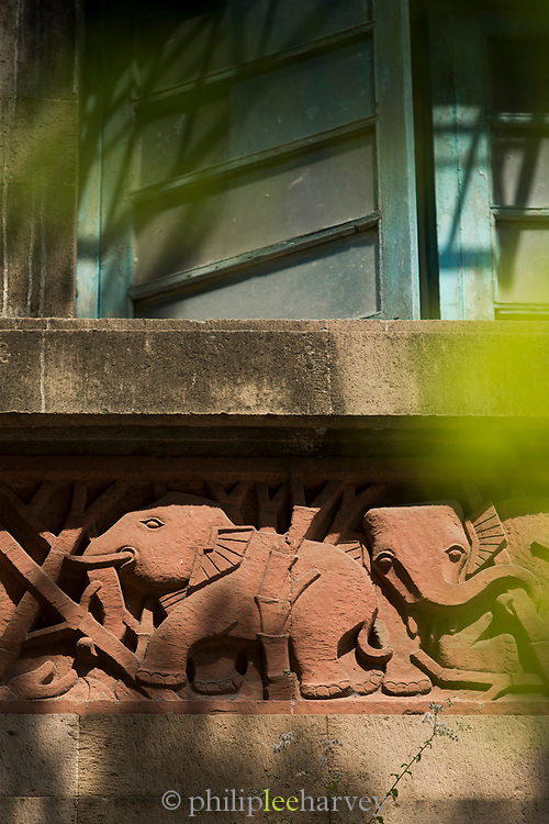 Close-up of elephant sculpture on house under window, Mumbai, India
