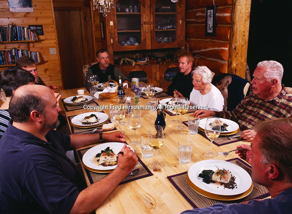 Bob Griffin, Patty Park, Dan Dowd, Carl Dixon, Brian Dowd, Madeleine Kamman, Alan Kamman and Tom Dowd enjoying dinner of baked halibut and Swiss chard, Winterlake Lodge, Alaska.