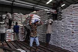 January 30, 2018 - Lhokseumawe, Aceh, Indonesia - Workers seen transporting rice to be distributed to needy families in Bulog Lhokseumawe Warehouse. The Indonesian government distributes free rice to 10 million beneficiary families (KPM), totaling 10 kilograms per month to all parts of  Indonesia. (Credit Image: © Maskur Has/SOPA via ZUMA Wire)