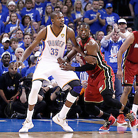 12 June 2012: Miami Heat shooting guard Dwyane Wade (3) defends on Oklahoma City Thunder small forward Kevin Durant (35) during the Oklahoma City Thunder 105-94 victory over the Miami Heat, in Game 1 of the 2012 NBA Finals, at the Chesapeake Energy Arena, Oklahoma City, Oklahoma, USA.