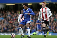 Willian of Chelsea (L) fending off Ryan Woods of Brentford (R) The Emirates FA Cup 4th round match, Chelsea v Brentford at Stamford Bridge in London on Saturday 28th January 2017.<br /> pic by Steffan Bowen, Andrew Orchard sports photography.