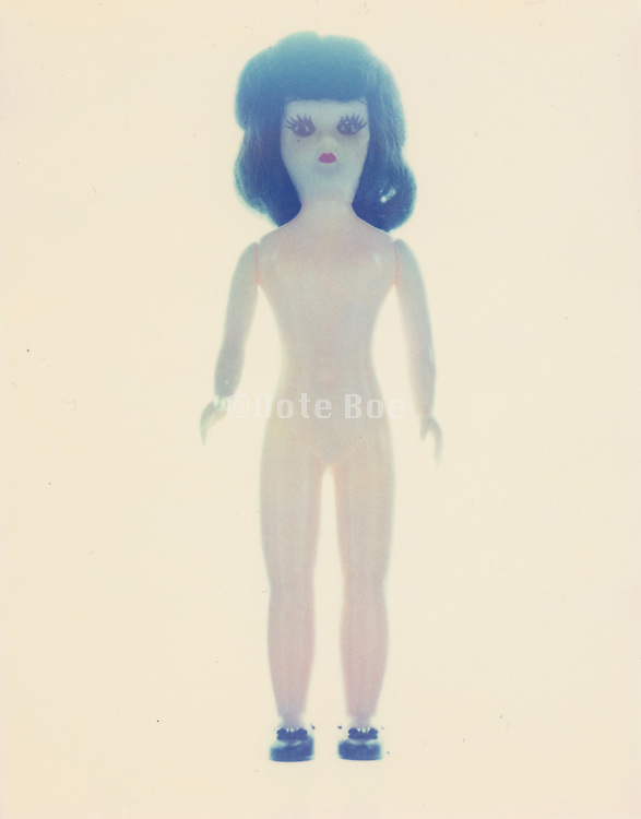 A nude toy female figure