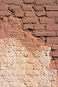 Weathered adobe wall on the Fairbanks Hotel, ghost town of Fairbanks, Arizona USA