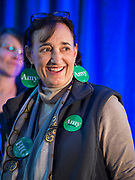 """01 FEBRUARY 2020 - DES MOINES, IOWA: ELLEN LUGER, from Minneapolis, a close friend of US Senator Amy Klobuchar (D-MN) wears """"Amy Earrings"""" before a campaign event for Sen. Klobuchar. Sen. Klobuchar campaigned to support her candidacy for the US Presidency Saturday in Iowa. She is trying to capitalize on her recent uptick in national polls. Iowa holds the first selection event of the presidential election cycle. The Iowa Caucuses are Feb. 3, 2020.              PHOTO BY JACK KURTZ"""