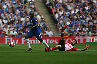 Football - 2017 / 2018 FA Cup - Semi Final: Chelsea vs. Southampton<br /> <br /> N'Golo Kante of Chelsea skips past the tackle from Southampton's Charlie Austin at Wembley Stadium <br /> <br /> COLORSPORT/SHAUN BOGGUST