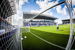 Falkirk FC keeper Michael McGovern in the goals during the pre-game warm-up. The Falkirk Stadium, with the new pitch work for the Scottish Championship game v Morton. The woven GreenFields MX synthetic turf and the surface has been specifically designed for football with 50mm tufts compared with the longer 65mm which has been used for mixed football and rugby uses.  It is fully FFA two star compliant and conforms to rules laid out by the SPL and SFL.<br /> ©Michael Schofield.