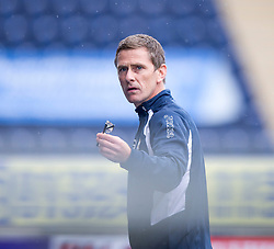 East Fife's manager Gary Naysmith with someone's glasses. Falkirk 3 v 1 East Fife, Petrofac Training Cup played 25th July 2015 at The Falkirk Stadium.