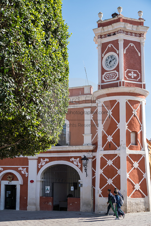 The colonial style town hall decorated in red and white in the town square in the beautiful historic village of Bernal, Queretaro, Mexico. Bernal is a quaint colonial town known for the Pena de Bernal, a giant monolith which dominates the tiny village is the third highest on the planet.
