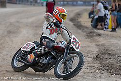 George Wills (no. 20) on his Harley-Davidson tank-shift Flathead racer in the Hooligan races on the temporary track in front of the Sturgis Buffalo Chip main stage during the Sturgis Black Hills Motorcycle Rally. SD, USA. Wednesday, August 7, 2019. Photography ©2019 Michael Lichter.