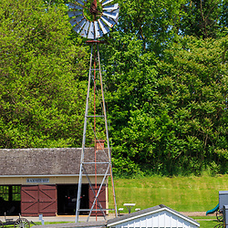Strasburg, PA, USA - May 23, 2018: An operational wind mill located at the Amish Village in Lancaster County, a popular tourist attraction.