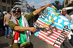 October 8, 2018 - Gaza City, Gaza Strip - Palestinians burn an Israeli, British and U.S. flags in front of the Red cross office during a protest to show solidarity with Palestinian prisoners held in Israeli jails. (Credit Image: © Mahmoud Ajjour/APA Images via ZUMA Wire)