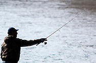 A man fishes in the Neversink River in Cuddebackville, New York, on the opening day of trout season in New York State.