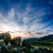 Basalt boulders are set against the setting sun in the Lamar Valley of Yellowstone National Park Wyoming.