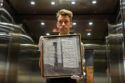 """© Licensed to London News Pictures. 02/06/2017. London, UK.   A technician presents """"White Doors"""", 1899, by Vilhelm Hammerhøi (Est. GBP 400-600k).  Preview of Sotheby's sale of 19th century European paintings which takes place on 6 June 2017 at Sotheby's in New Bond Street. Photo credit : Stephen Chung/LNP"""