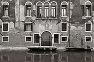 The facade of  a palace  on Rio della Sensa, a canal in the Sestiere of Cannaregio in Venice, Italy