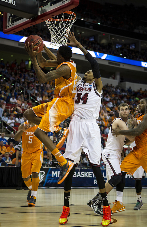Tennessee Volunteer's guard Jordan McRae (52) takes the ball to the basket against UMASS forward Raphiael Putney (34) at PNC Arena on March 21 during the NCAA Men's Division I Round of 64 games. Tennessee went on to win 86-67 to advance to the Round of 32 against Mercer.