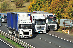 © Licensed to London News Pictures. 12/10/2018<br /> WROTHAM, UK.<br /> Traffic on the M26 at Wrotham, A lorry is parked up in the emergency lane while others pass.<br /> The M26 motorway in Kent is to be closed at night so it can be turned into a giant lorry park incase Britain leaves the EU with no deal. The M26 connects the M25 to the M20 towards Dover.<br /> Photo credit: Grant Falvey/LNP