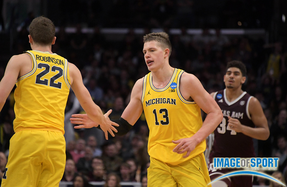 Michigan Wolverines forward Moritz Wagner (13) and guard Duncan Robinson (22) during a West Regional semifinal of the NCAA men's college basketball tournament, Thursday, March 22, 2018, in Los Angeles. Michigan defeated Texas A&M 99-72.