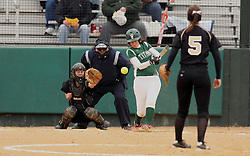 30 March 2013:  Kaity Crane batting during an NCAA Division III women's softball game between the DePauw Tigers and the Illinois Wesleyan Titans in Bloomington IL<br /> <br /> Umpire is Jay MacDaniels of Pekin IL