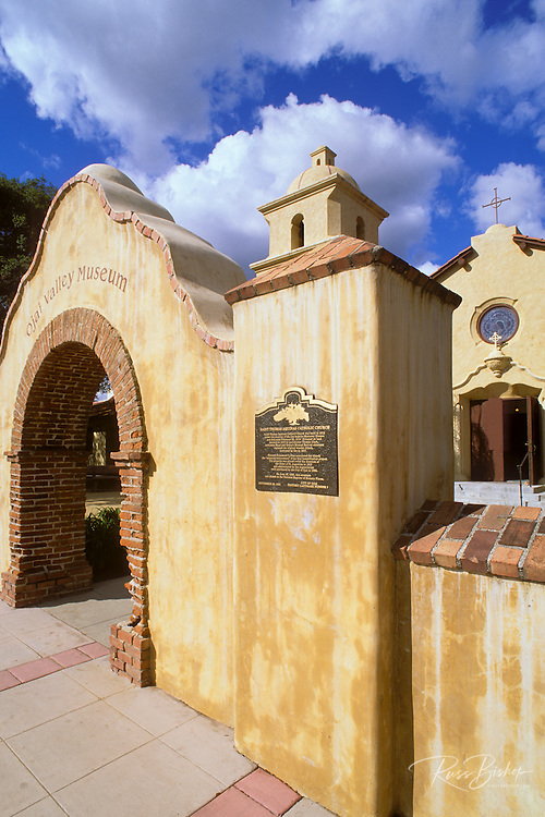 Archway and historic plaque at the entrance to Saint Thomas Aquinas Catholic Church, Ojai, California