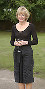 Julia Peyton-Jones. Serpentine Gallery Summer party in a glass and steel pavilion designed by Toyo Ito and Arup. . tuesday 9 July 2002. © Copyright Photograph by Dafydd Jones 66 Stockwell Park Rd. London SW9 0DA Tel 020 7733 0108 www.dafjones.com