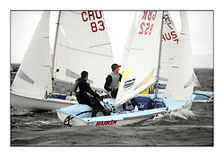 470 Class European Championships Largs - Day 2.Wet and Windy Racing in grey conditions on the Clyde...GBR852, Philip SPARKS, David KOHLER,  RLYC..