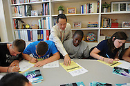 Wellesley Middle School principal Mark Ito works with students during  the homeroom period that he teaches in his office, on the first day of school, Wednesday, Sept. 2, 2015.<br /> Wicked Local staff photo / Kate Flock
