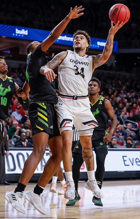 CINCINNATI, OH - JANUARY 15: Jarron Cumberland #34 of the Cincinnati Bearcats shoots the ball against Michael Durr #4 of the South Florida Bulls during the second half of the game at Fifth Third Arena on January 15, 2019 in Cincinnati, Ohio. (Photo by Michael Hickey/Getty Images) *** Local Caption *** Jarron Cumberland; Michael Durr
