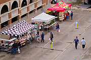 15 MAY 2021 - DES MOINES, IOWA: Socially distanced vendors' booths at the Des Moines Farmers Market. The Des Moines Farmers Market is the largest weekly Farmers Market in Iowa. The market was largely cancelled in 2020 because of COVID-19 pandemic, but reopened in a limited way in 2021. In order to comply with Coronavirus safety guidelines, traffic is one way past the stands and people are required to wear face masks. Traditionally about 25,000 people attended the Saturday morning market, and about 40,000 people attended market on the opening day, the first Saturday in May. This year there will be about 115 vendors, 75% the normal number of vendors. As the CDC rolls back Coronavirus guidelines, the market is expanding. The market will expand Memorial Day weekend to include prepared food stands and children's activities.          PHOTO BY JACK KURTZ