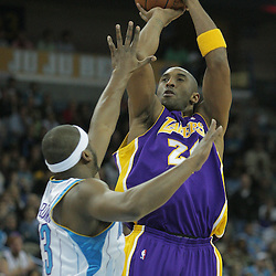 23 December 2008: Los Angeles Lakers guard Kobe Bryant (24) shoots over New Orleans Hornets guard Devin Brown (23) during a 100-87 loss by the New Orleans Hornets to the Los Angeles Lakers at the New Orleans Arena in New Orleans, LA. .