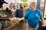 """Sept. 27 - PHOENIX, AZ: DOTTIE BARRETT, a volunteer, serves lunch to clients at the Society of St. Vincent de Paul in Phoenix, Monday Sept. 27. She's been volunteering with a group for Triple R Behavioral Health for about four years. September 27, 2010 is the 350th Feast Day of Saint Vincent de Paul, also known as the """"Apostle of Charity."""" To mark the day, the Society of St. Vincent de Paul in Phoenix served birthday cake during the lunch service. The US Census office recently announced that poverty in the US has spiked to 14.3% of the population, the highest poverty rate since 1994. Officials at St. Vincent de Paul in Phoenix said that demand for their services have increased steadily in the last three years. They currently feed about 1,100 people, either homeless or members of the working poor, every day.    Photo by Jack Kurtz"""