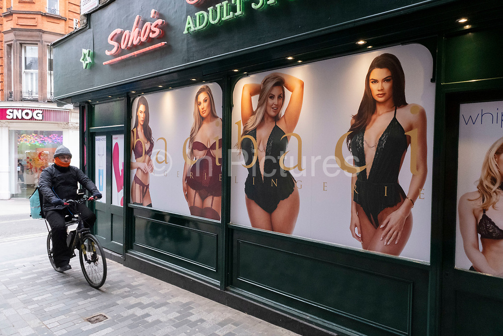 Female models of different sizes model lingerie in photographs outside Sohos Original Adult Store in Soho on 5th March 2021 in London, England, United Kingdom. Traditionally, this area of the West End has been the centre of the adult entertainment industry in London, UK with shops selling adult industry goods like this landmark shop.