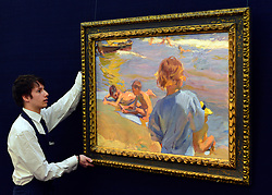 © Licensed to London News Pictures. 17/05/2013. London, UK JOAQUÍN SOROLLA, SPANISH, 1863 - 1923.NIÑOS EN LA PLAYA, VALENCIA(CHILDREN ON THE BEACH, VALENCIA) Estimate: 1,800,000 - 2,500,000 GBP A photo call for a preview of 19th Century European Paintings held at Sotheby's London today 17th May 2013. The paintings will be offered to auction on 23 May 2013. Photo credit : Stephen Simpson/LNP