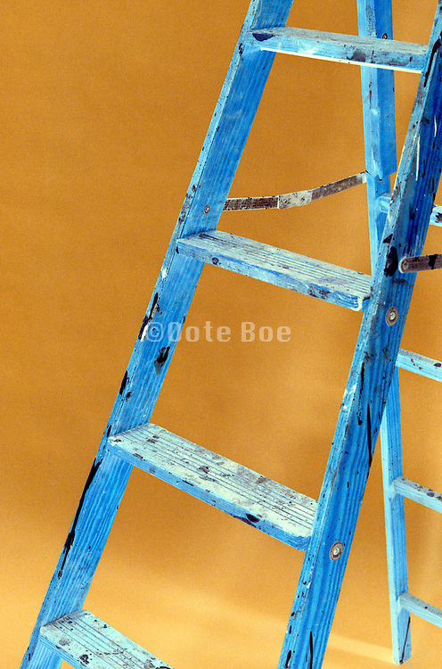 ladder with spattered black paint