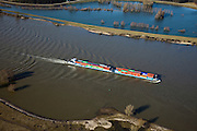 Nederland, Gelderland, Gemeente Beuningen, 07-03-2010; binnenvaartschip op de Waal, ter hoogte van Ewijk. Containers in duwbakvaart..Barge on the river Waal, near Ewijk. Lighteer shipping containers..luchtfoto (toeslag), aerial photo (additional fee required).foto/photo Siebe Swart