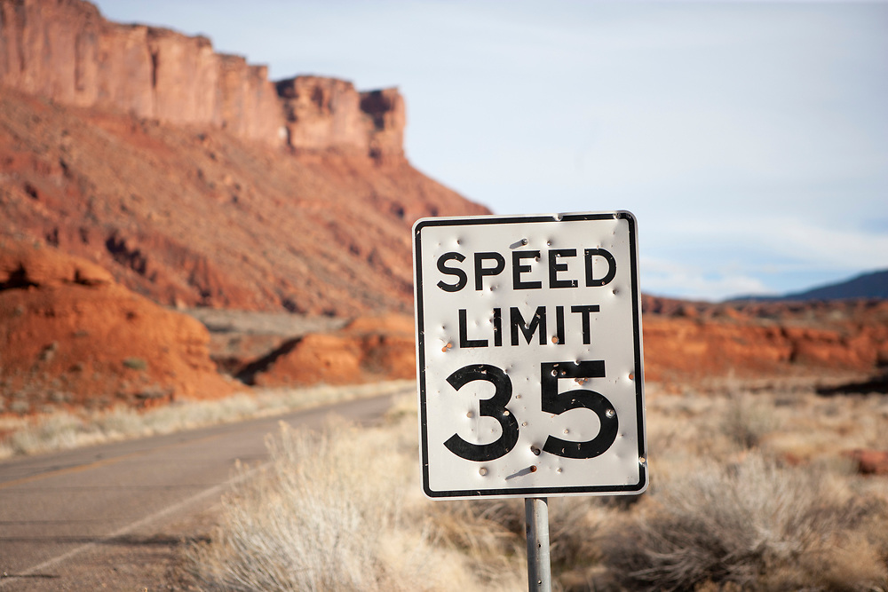 Bullet holes riddle a 35 mph speed sign in the Red Rock country of southern Utah