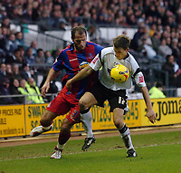 Photo: Kevin Poolman.<br />Derby County v Crystal Palace. Coca Cola Championship. 16/12/2006. Shefki Kuqi of Palace and Paul Boertien of Derby fight over the ball.
