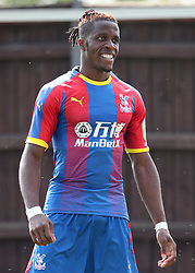 Crystal Palace's Wilfired Zaha celebrates scoring his side's first goal of the game during a pre season friendly match at The Kassam Stadium, Oxford