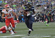 Aug 25, 2017; Seattle, WA, USA; Seattle Seahawks running back Eddie Lacy (27) is pursued by Kansas City Chiefs outside linebacker Frank Zombo (51) during a NFL football game at CenturyLink Field.