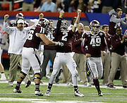 ATLANTA, GA - DECEMBER 31:  Quarterback Johnny Manziel #2 of the Texas A&M Aggies (center) celebrates with teammates Mike Matthews #56 (left) after a touchdown during the Chick-fil-A Bowl game against the Duke Blue Devils at the Georgia Dome on December 31, 2013 in Atlanta, Georgia.  (Photo by Mike Zarrilli/Getty Images)