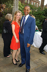 ADAM AFRIYIE MP  and his wife TRACY-JANE at the annual Macmillan Cancer Support House of Lords vs the House of Commons Tug of War held in Victoria Tower Gardens on 20th June 2006.<br /><br />NON EXCLUSIVE - WORLD RIGHTS
