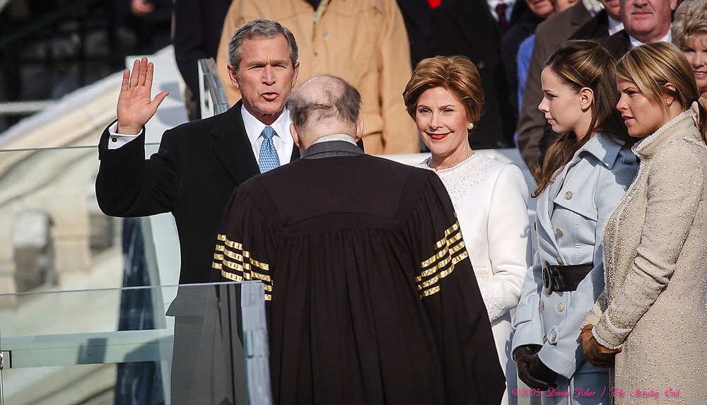 WASHINGTON, D.C. - Chief Justice William Rehnquist administers the presidential oath of office to George W. Bush as First Lady Laura Bush and daughters Barbara and Jenna Bush watch.  Inauguration ceremonies for the second term of President George W. Bush at the U.S. Capitol, along the National Mall and along Pennsylvania Avenue on January 19, 2005 and January 20, 2005. Photography ©DONNA FISHER/The Morning Call