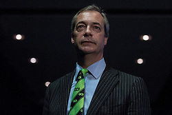"© Licensed to London News Pictures . 05/02/2016 . Manchester , UK . NIGEL FARAGE wearing a lime green "" Grassrooots Out "" tie . Grassroots Out , anti-EU membership campaign event , at the Manchester Central Convention Centre . Photo credit : Joel Goodman/LNP"
